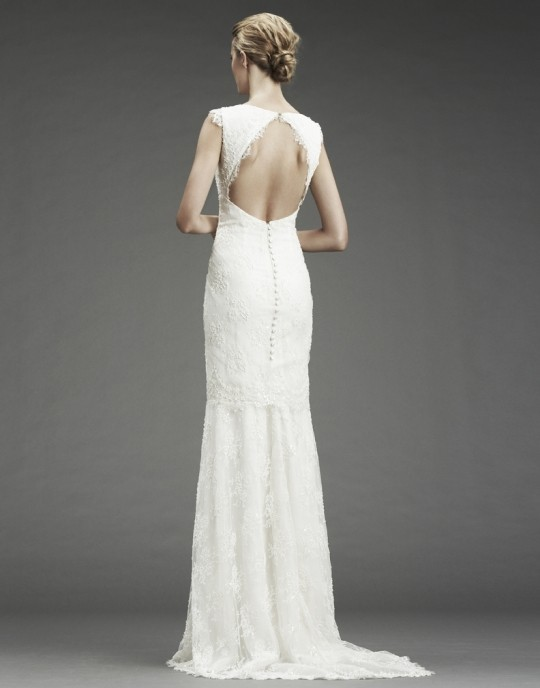 Beaded lace gown with lace trim and cutout back with button detail