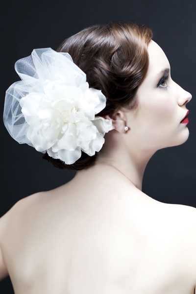 We love Sara Gabriel, our store newest wedding designer addition - headpieces, veils and jewelry