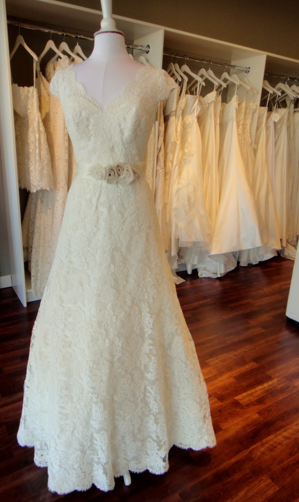 Lace wedding dress with deep cut back detail